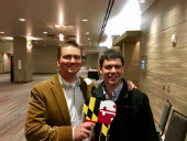 Photo of Alumni with Maryland tooth at ADA reception