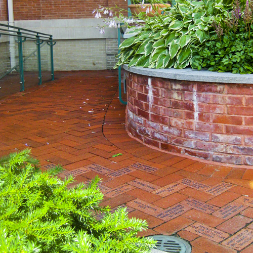 Image of courtyard with engraved bricks