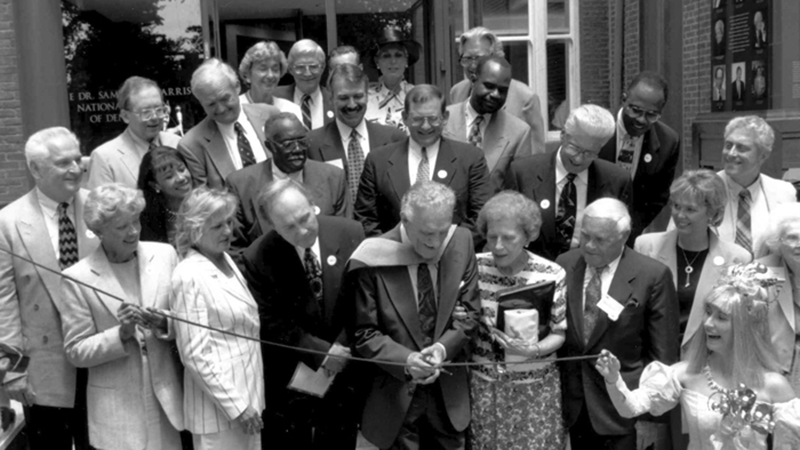 Image of Dr. Samuel D. Harris and other benefactors of the National Museum of Dentistry cutting the ribbon for the opening ceremony on June 21st, 1996.