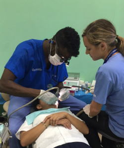 School of Dentistry student Biniat Kabir '17 operates on Honduran patient