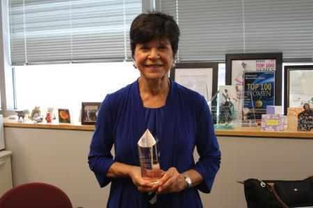 Photograph of Jackie Fried with Irene Newman award