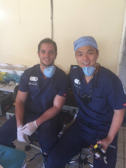Eduardo Cruz, DDS, third-year endodontics resident at Harvard School of Dental Medicine, and Juheon Seung, DDS, endodontics resident at UMSOD, performed root canals at the Helping Hands Clinic.