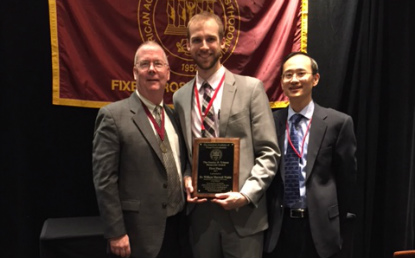 William Wahle, Prosthodontics resident, with Carl Driscoll, DMD, and Dr. Fei Liu of the American Academy of Fixed Prosthodontics.