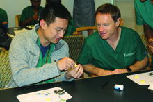 Dan Yang and Ben Horn learn to check blood glucose levels