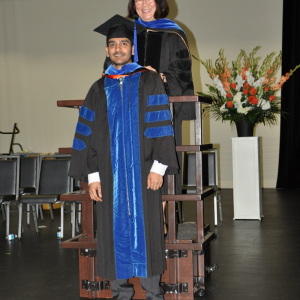 Dr. Lowe at student hooding ceremony