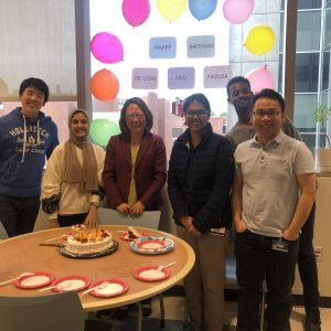 Dr. Lowe and students at a birthday party