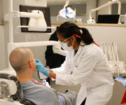 A dentist working with a patient in a dental chair