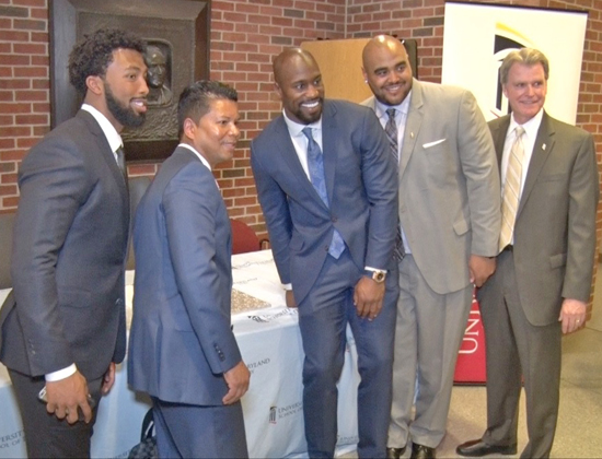 School of Dentistry Dean and Professor Mark Reynolds, DDS '86, PhD, far right, is joined by alumnus Michael Wright, DDS '99, MS; second from left; and Washington Redskins players Kendall Fuller, far left; Vernon Davis, center, and A.J. Francis, MPP, second from right, in observing National Facial Protection Month.