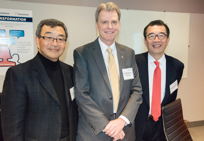 Left to right, James F. Chen, MS, chairman, chief executive officer, and founder of DrFirst; Mark A. Reynolds, DDS, PhD, MA, dean and professor of the UM School of Dentistry (UMSOD); and Charles Chen, DDS, a member of the UMSOD Dean's Faculty.